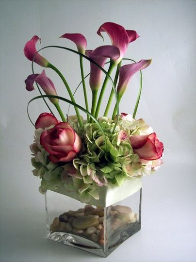 Calla lily, rose and green hydrangea river rock in vase