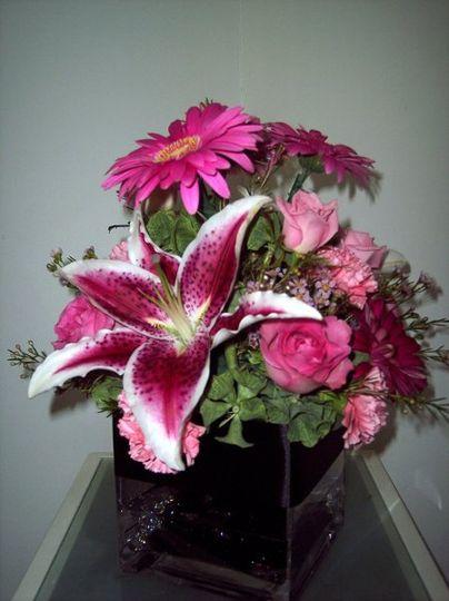 Stargazer lily highlights this arrangement