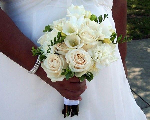 White roses with white freesia