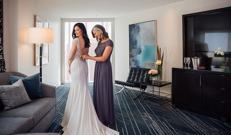Mom and bride getting ready in prestige suite