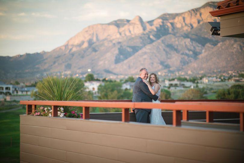 Couple posing with mountain vista