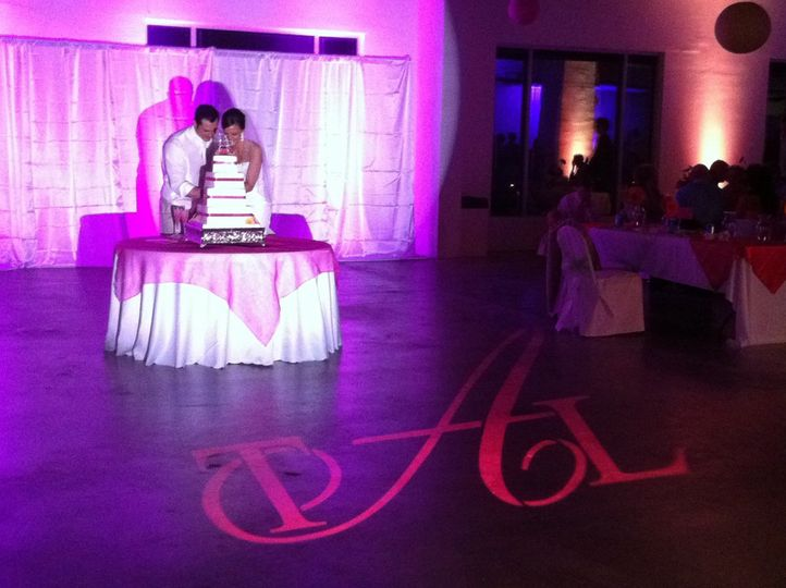 Pipe Drape with Uplighting, Cake Pinspotting and Color Monogram