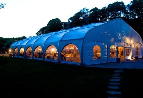 Beautiful evening view of reception tent at Misselwood at Endicott College, Beverly MA