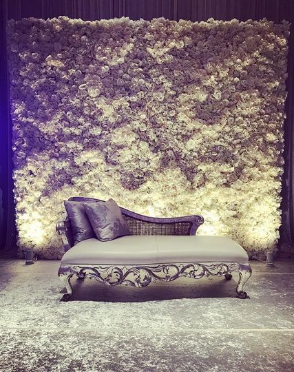 Couple's couch with rose backdrop