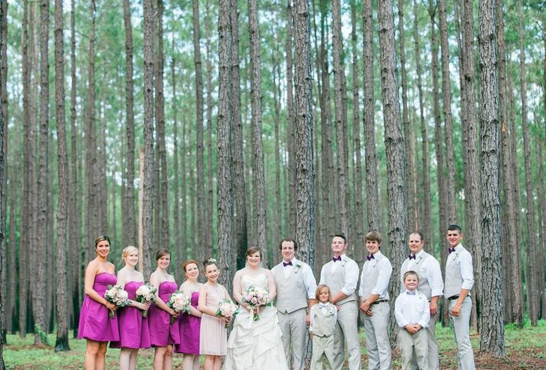Newlyweds and their guests in the woods