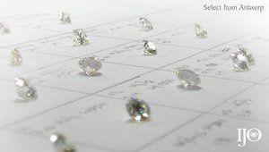 Hand selecting loose diamonds