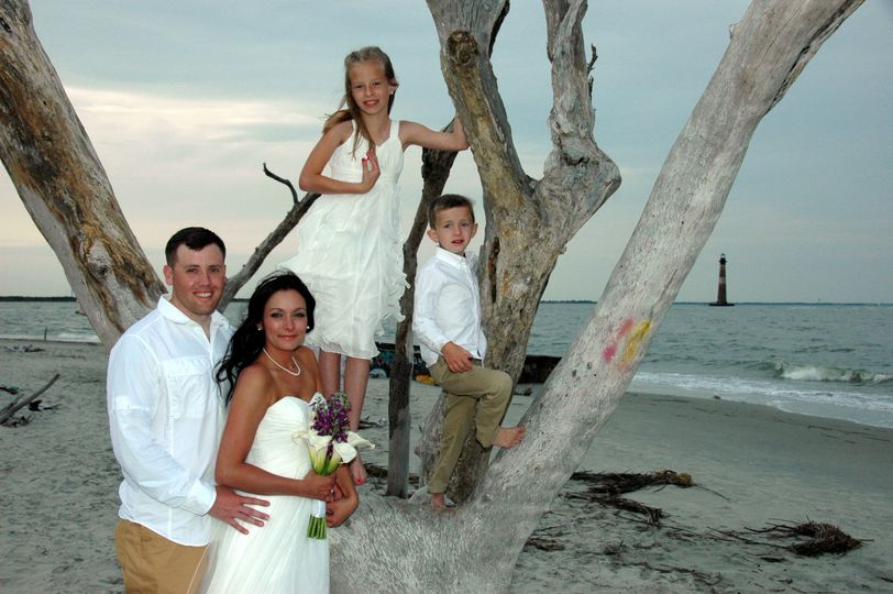 Family photo on the beach near Morris Island Lighthouse - Folly Beach SC