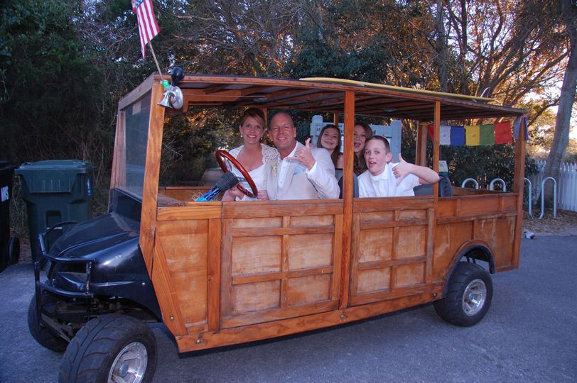 A right back to their beach house by a retro golf cart - Sullivan's Island SC