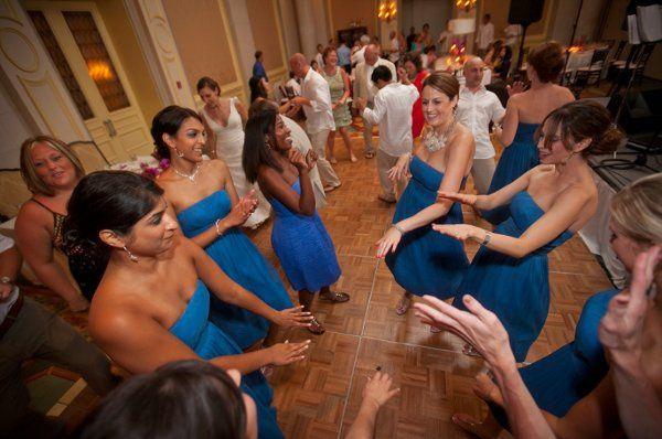 bridesmaids dancing to the band Extasis