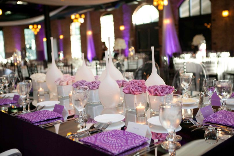 Purple ombre head table with custom napkins and blown glass vases.  copyright: Kelly Brown Weddings