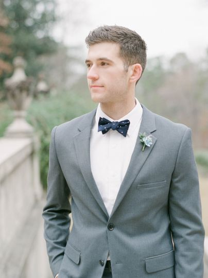 Grey suit with navy bow tie