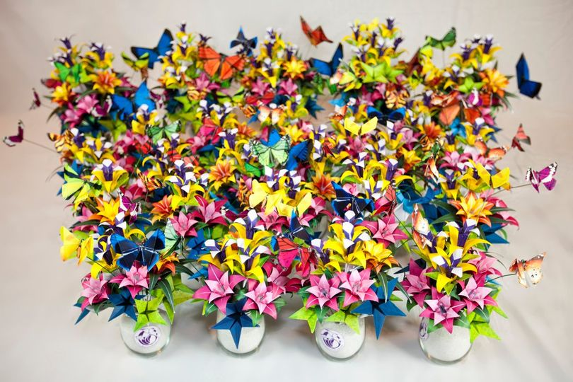 We made 25 origami flower and butterfly bouquets for the Butterfly Pavilion's Living Lights event...