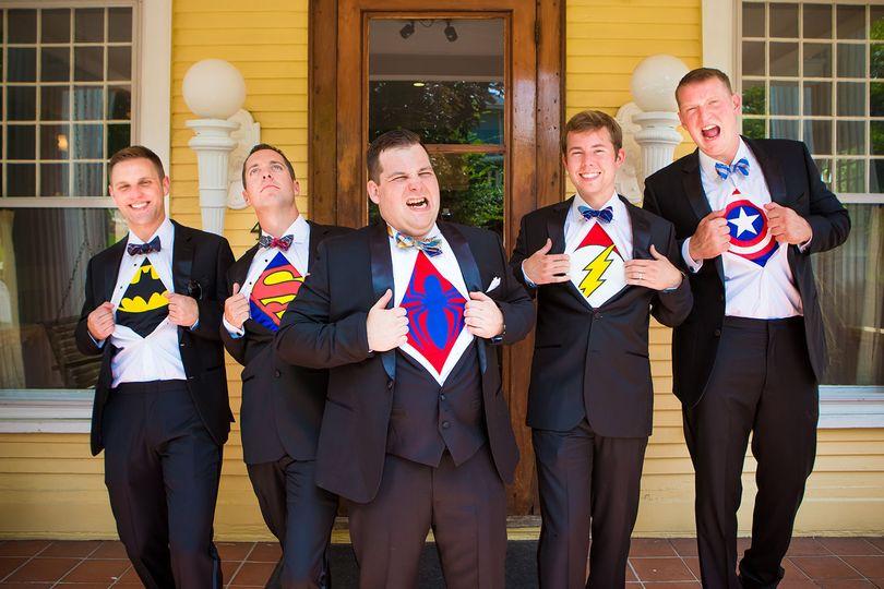 Groom and groomsmen as superheroes in Bloomington outdoor wedding.