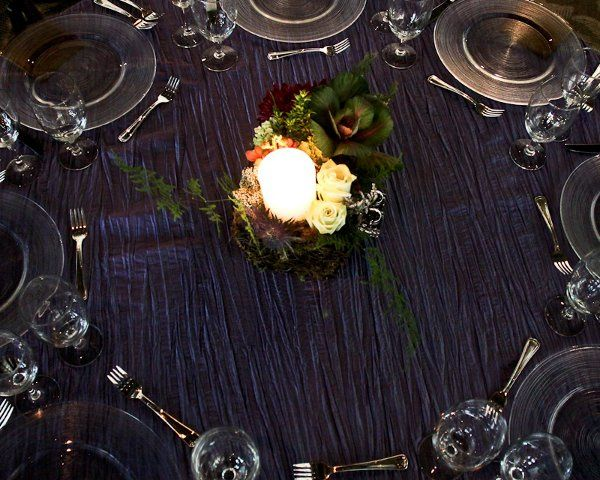 The English Garden created natural centerpieces to add to the forest feel of the event.   Photo by...
