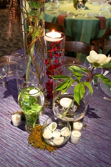 The English Garden created several types of arrangements including full centerpieces and gathered...
