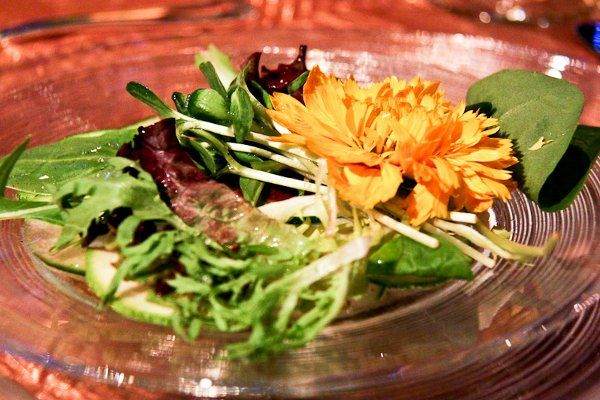 A close up look at the raw salad (including an edible flower)!  Photo by Spots of Time Photography