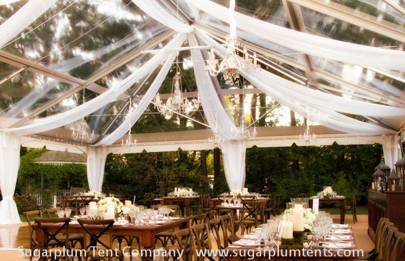 White tulle swagging with crystal chandeliers & dark furniture make a beautiful combo.