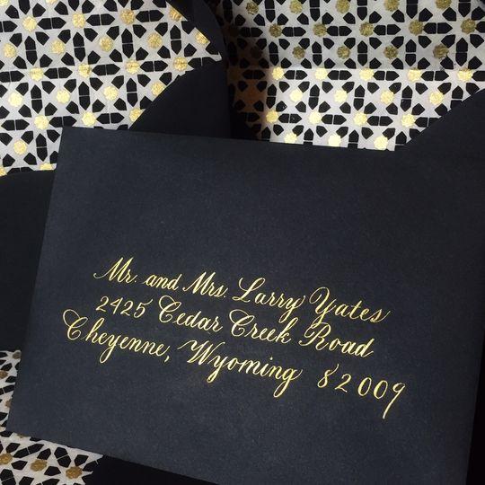 Copperplate script in gold ink