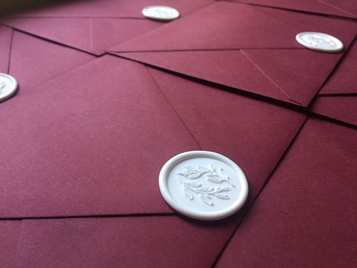 Burgundy with white seals