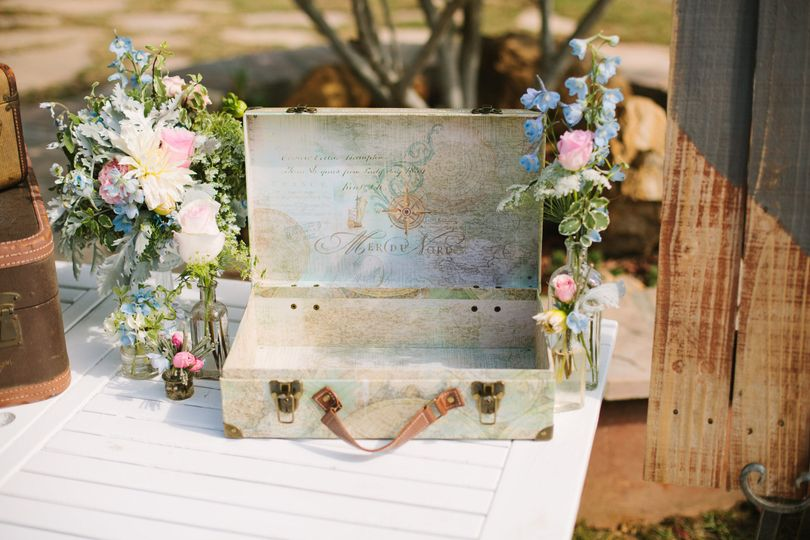 Cards accented with florals in vintage bottles.