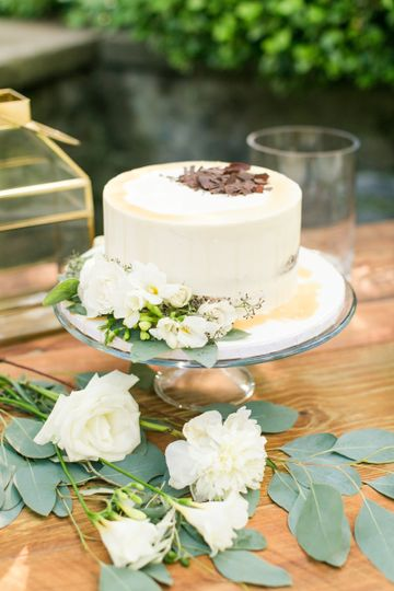 Buttercream Naked Cake with chocolate shavings and caramel