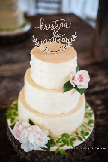 Buttercream wedding cake with topper