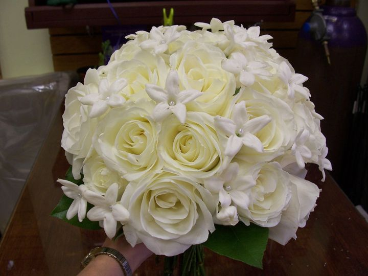 Clutch style bouquet of white roses and stephanotis