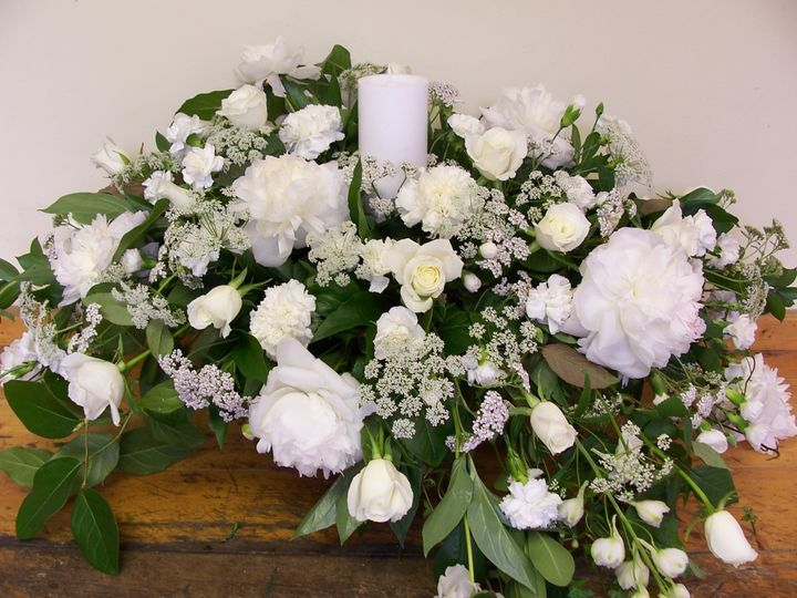 Alter arrangement of white roses, peonies, Queen Ann's Lace and delphinium.