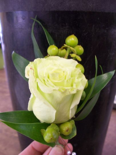 Boutonniere of hypericum & rose.
