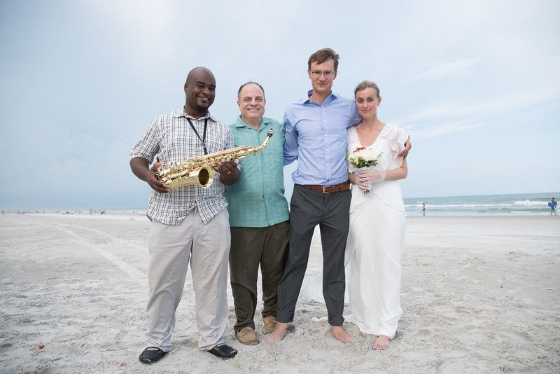 Musician, officiant, and the newlyweds