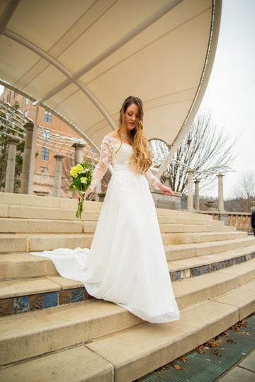 Walking down the steps in a long white gown