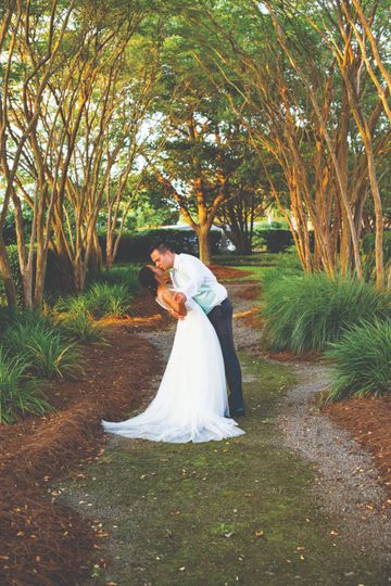 An embrace under the canopy of trees