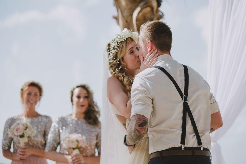 Wedding Ceremony First Kiss Photo at the Key Largo Lighthouse Beach by La Vie Studios