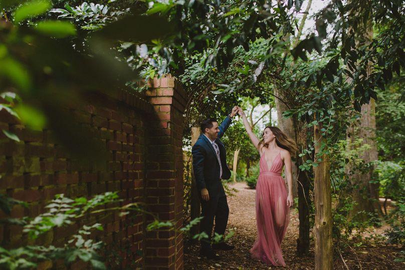 Candid North Carolina Garden Engagement Photos by La Vie Studios