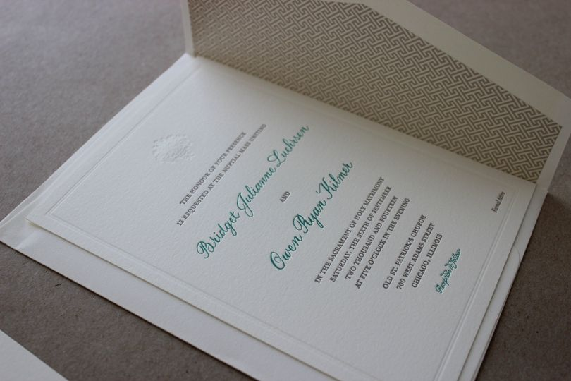 White invitation with a touch of blue ink
