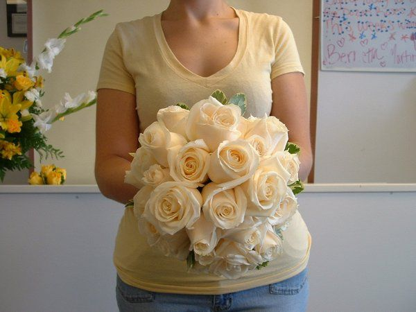 Bridal Bouquet hand tied with 2dz Ivory roses.