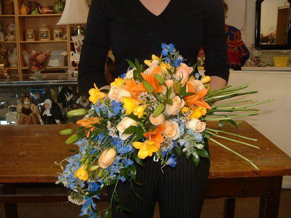 Bridal Bouquet with Asiatic Lilies, Blue Delphenium & Roses.