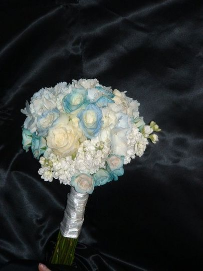 Bridal bouquet hand tide with roses & blue hydrangas.