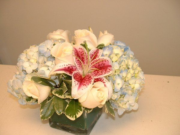 Centerpiece with Stargazer lilies, blue hydranga & roses.
