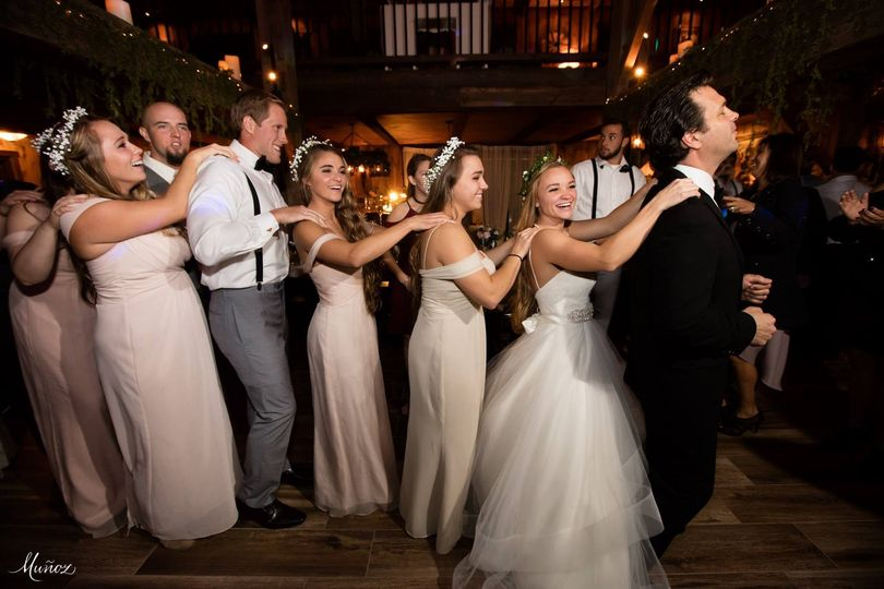 Guests and newlyweds line dancing