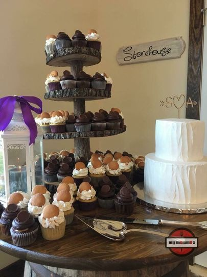 2 tier cake with cupcakes