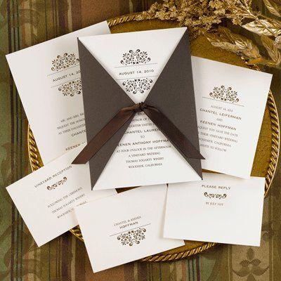 This ecru tiffany invitation card features an elegant lazer-cut design that is enclosed in a mocha...