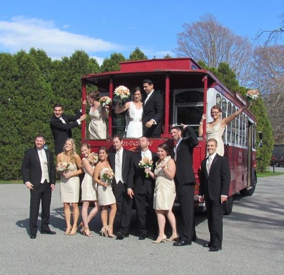 Newlyweds, bridesmaids, and groomsmen on the trolley