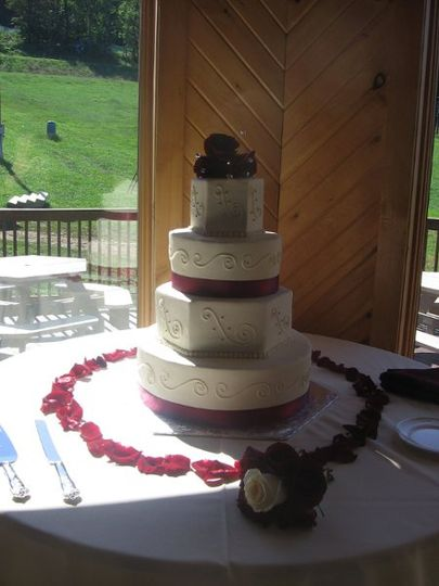 Round & Octogon layered buttercream cake with scroll work, silver dragees, burgundy ribbon and red...