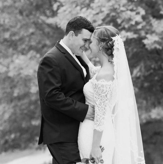 Newlyweds posing in black and white