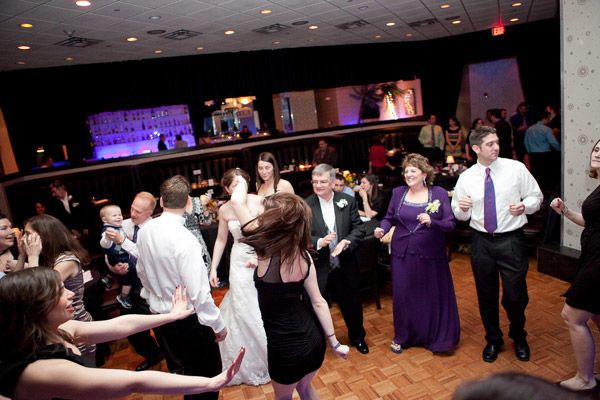 Dancing couple and their guests