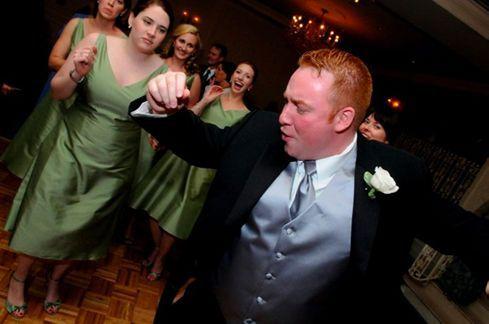 Dancing groom and bridesmaid
