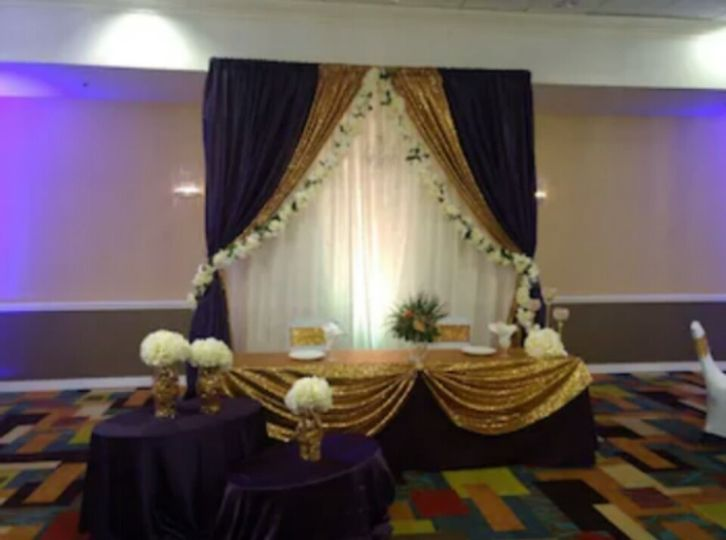 Decadent purple and gold sweetheart table