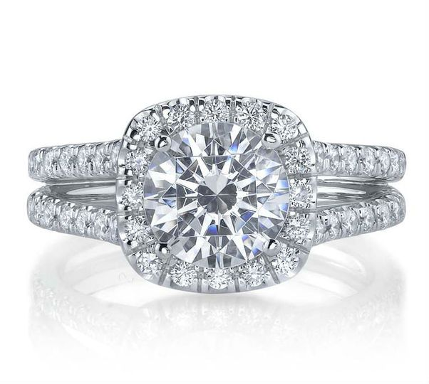 This is a stunninfg round diamond halo engagement ring with a split shank setting available at...