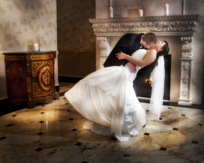 A romantic, playful photo by the fire place.